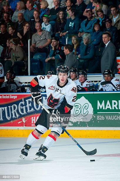 Jake Bean of Calgary Hitmen skates with the puck against the Kelowna Rockets on October 24 2015 at Prospera Place in Kelowna British Columbia Canada