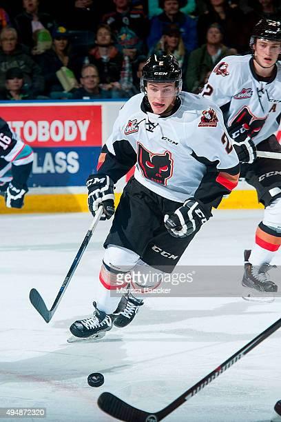 Jake Bean of Calgary Hitmen skates with the puck against the Kelowna Rockets on October 24 2015 at Prospera Place in Kelowna British Columbia Canada