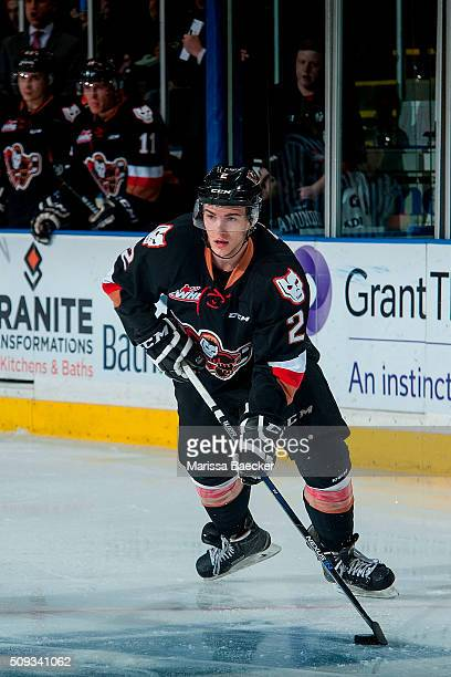 Jake Bean of Calgary Hitmen skates with the puck against the Kelowna Rockets on February 6 2016 at Prospera Place in Kelowna British Columbia Canada