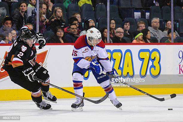 Jake Bean of the Calgary Hitmen looks to check Andrew Koep of the Edmonton Oil Kings during a WHL game at Scotiabank Saddledome on December 5 2014 in...