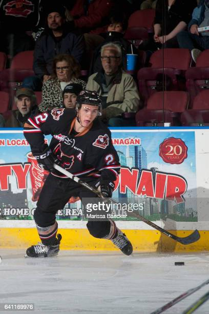 Jake Bean of the Calgary Hitmen skates with the puck against the Kelowna Rockets on February 1 2017 at Prospera Place in Kelowna British Columbia...