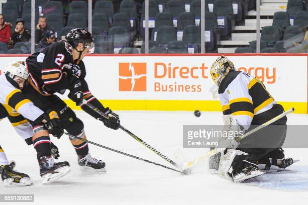 Jake Bean of the Calgary Hitmen takes a shot on Logan Thompson of the Brandon Wheat Kings during a WHL game at the Scotiabank Saddledome on October 8...