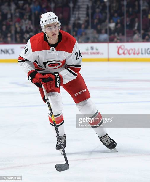 Jake Bean of the Carolina Hurricanes skates against the Montreal Canadiens in the NHL game at the Bell Centre on November 27 2018 in Montreal Quebec...