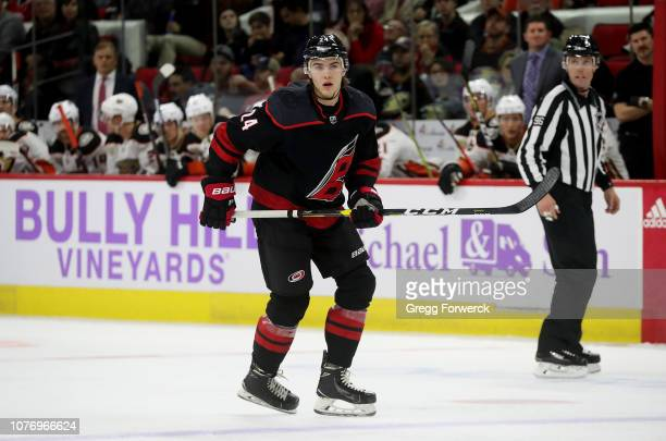 Jake Bean of the Carolina Hurricanes skates for position on the ice during an NHL game against the Anaheim Ducks on November 30 2018 at PNC Arena in...