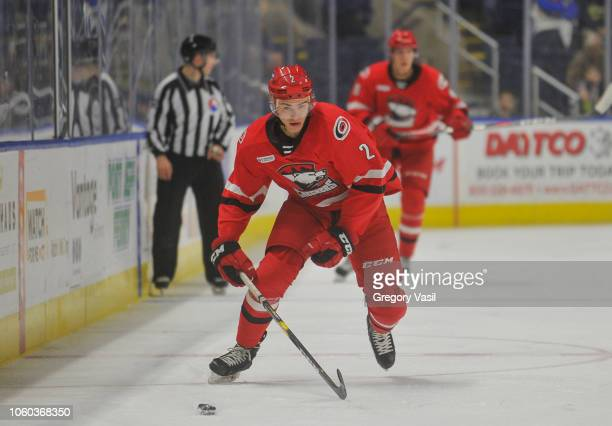 Jake Bean of the Charlotte Checkers brings the puck up ice during a game against the Bridgeport Sound Tigers at the Webster Bank Arena on November 11...