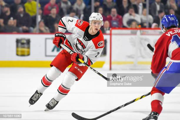 Jake Bean of the Charlotte Checkers in control of the puck on the tip of his blade against the Laval Rocket at Place Bell on December 28 2018 in...