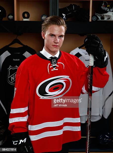 Jake Bean selected 13th overall by the Carolina Hurricanes poses for a portrait during round one of the 2016 NHL Draft at First Niagara Center on...