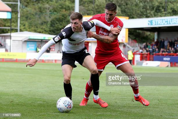 Jake Beesley of Salford City holds off Tom Dallison of Crawley Town during the Sky Bet League Two match between Crawley Town and Salford City at The...