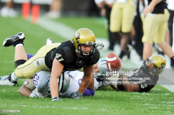 Jake Behrens of Colorado eyes the fumble by Rodney Stewart by KSU recovers