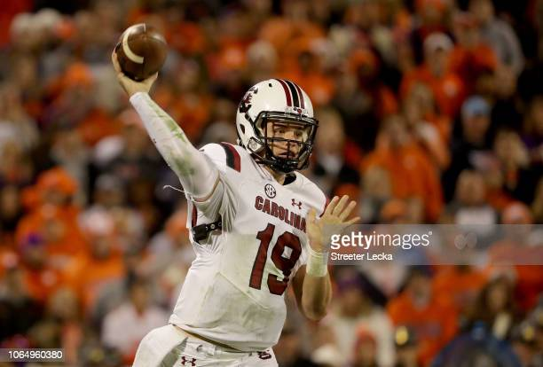 Jake Bentley of the South Carolina Gamecocks drops back to pass against the Clemson Tigers during their game at Clemson Memorial Stadium on November...