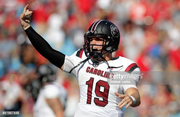 Jake Bentley of the South Carolina Gamecocks reacts after throwing a touchdown against the North Carolina State Wolfpack during their game at Bank of...