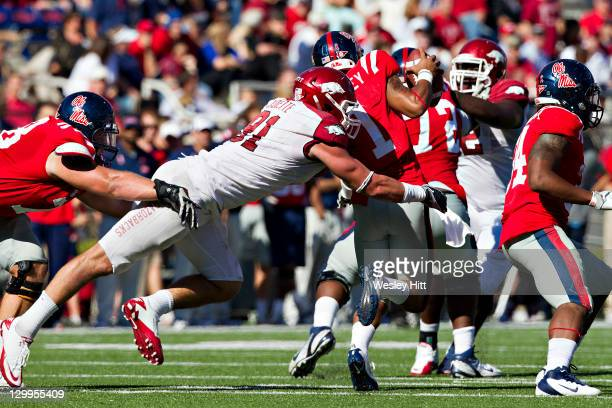 Jake Bequette of the Arkansas Razorbacks hits quarterback Randall Mackey of the Ole Miss Rebels at VaughtHemingway Stadium on October 22 2011 in...