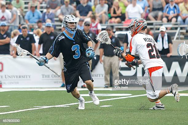 Jake Bernhardt of the Ohio Machine attempts to move the ball past Ethan Vedder of the Denver Outlaws on July 26 2014 at Selby Stadium in Delaware...