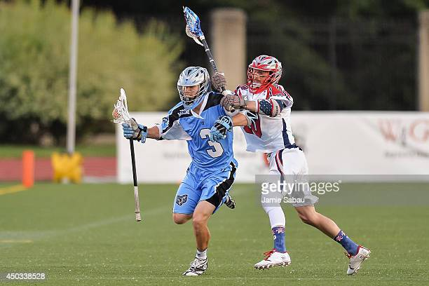 Jake Bernhardt of the Ohio Machine controls the ball as Stephen Berger of the Boston Cannons defends on June 6 2014 at Selby Stadium in Delaware Ohio