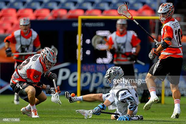 Jake Bernhardt of the Ohio Machine controls the ball with his foot as Drew Snider of the Denver Outlaws defends during the fourth quarter at Sports...