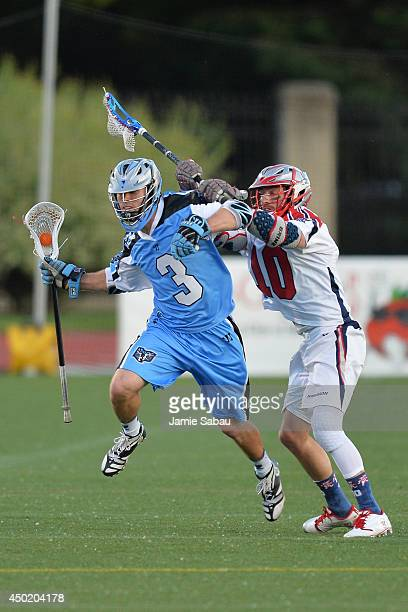 Jake Bernhardt of the Ohio Machine eludes the defense of Stephen Berger of the Boston Cannons as he takes the ball upfield in the second period on...