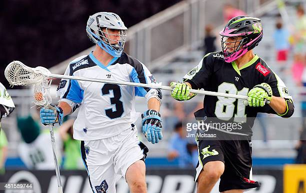 Jake Bernhardt of the Ohio Machine in action against Kyle Hartzell of the New York Lizards during their Major League Lacrosse game at Shuart Stadium...