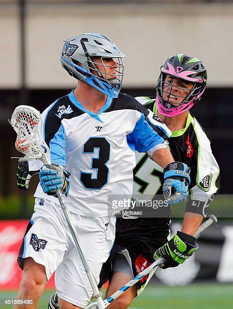 Jake Bernhardt of the Ohio Machine in action against Michael Kimmel of the New York Lizards during their Major League Lacrosse game at Shuart Stadium...