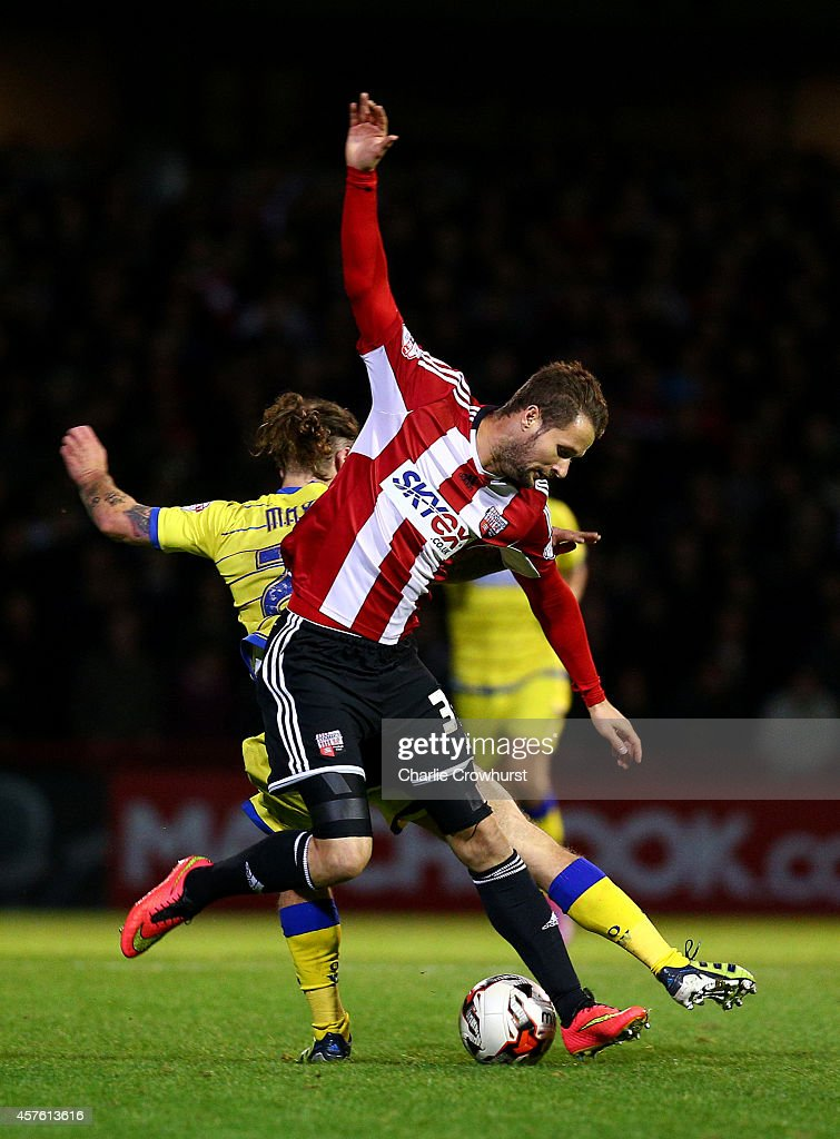 Jake Bidwell of Brentford clashes with Sheffield Wednesdays Stevie May during the Sky Bet Championship match between Brentford and Sheffield Wednesday at Griffin Park on October 21, 2014 in Brentford, England.