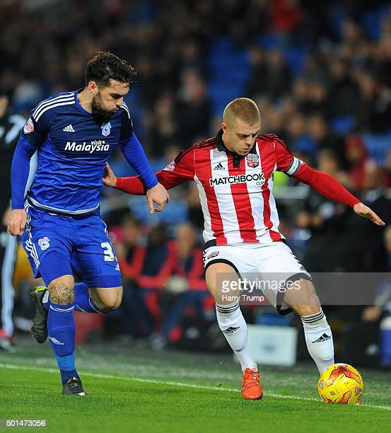 Jake Bidwell of Brentford is tackled by Tony Watt of Cardiff City during the Sky Bet Championship match between Cardiff City and Brentford at the...