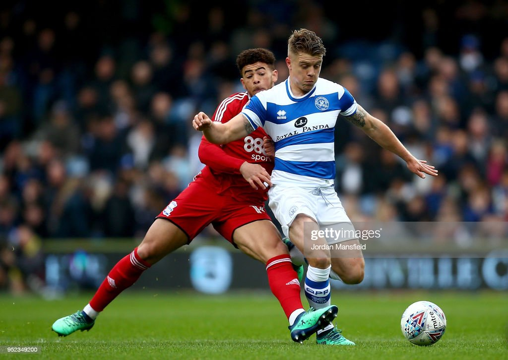 Jake Bidwell of QPR tackles with Che Adams of Birmingham during the Sky Bet Championship match between Queens Park Rangers and Birmingham City at Loftus Road on April 28, 2018 in London, England.