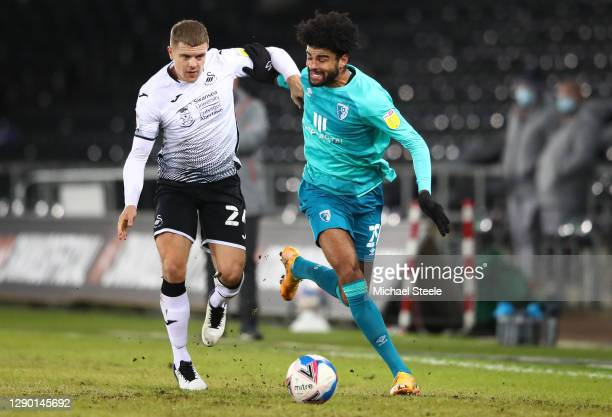 Jake Bidwell of Swansea City battles for the ball with Philip Billing of AFC Bournemouth during the Sky Bet Championship match between Swansea City...