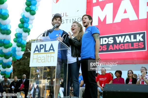 Jake Borelli Jaicy Elliot and Alex Blue Davis speak on stage during AIDS Walk Los Angeles 2019 on October 20 2019 in Los Angeles California