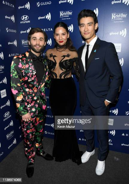 Jake Borelli Olivia Munn and Alex Landi attend the 30th Annual GLAAD Media Awards Los Angeles at The Beverly Hilton Hotel on March 28 2019 in Beverly...