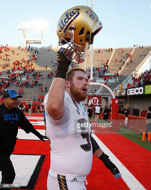 Jake Brendel of the UCLA Bruins raises his helmut as he leaves the field after the Bruins beat the Utah Utes at Rice Eccles Stadium on November 21...