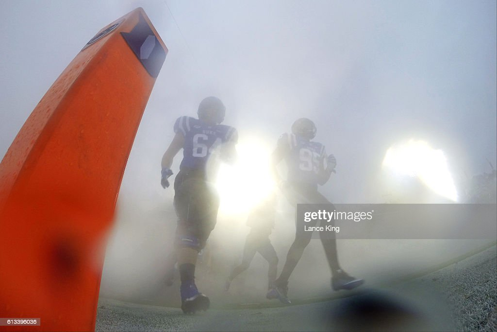 Jake Brodner #64 and Trevon McSwain #95 of the Duke Blue Devils run onto the field prior to their game against the Army Black Knights at Wallace Wade Stadium on October 8, 2016 in Durham, North Carolina.