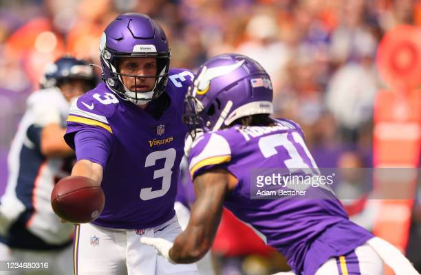 Jake Browning of the Minnesota Vikings hands off the ball to Ameer Abdullah of the Minnesota Vikings in the first quarter of pre-season play against...