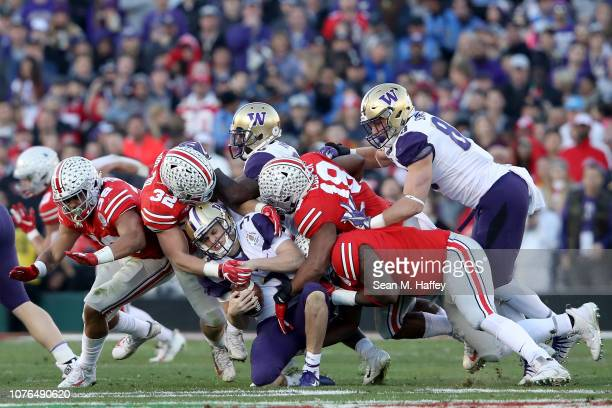 Jake Browning of the Washington Huskies is tackled during the second half in the Rose Bowl Game presented by Northwestern Mutual at the Rose Bowl on...