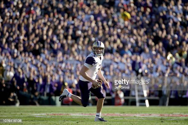 Jake Browning of the Washington Huskies scrambles during the first half in the Rose Bowl Game presented by Northwestern Mutual at the Rose Bowl on...