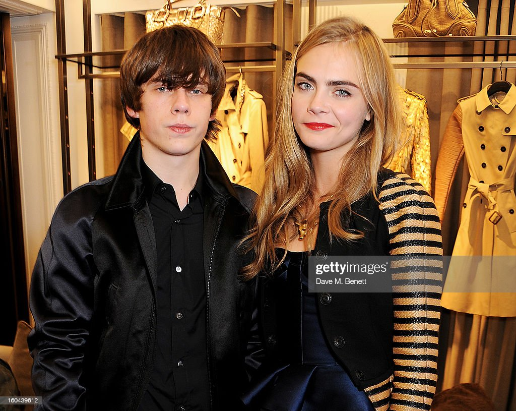 Jake Bugg (L) and Cara Delevingne, both wearing Burberry, attend the Burberry Live at 121 Regent Street event on January 31, 2013 in London, England.