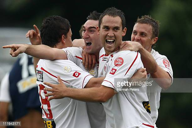Jake Butler and Jason Rowley of Waitakere celebrate with the team after winning the ASB Premiership Final between Auckland City and Waitakere United...