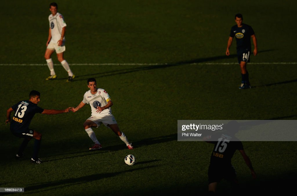 Jake Butler of Waitakere kicks the ball clear of Alex Feneridis of Auckland during the OFC Champions League Final match between Auckland and Waitakere at Mt Smart Stadium on May 19, 2013 in Auckland, New Zealand.