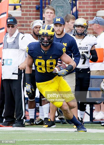 Jake Butt of the Michigan Wolverines carries the ball against the Colorado Buffaloes at Michigan Stadium on September 17 2016 in Ann Arbor Michigan