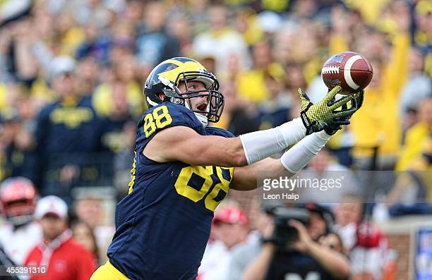 Jake Butt of the Michigan Wolverines catches a 29 yard pass for a third quarter touchdown during the game against the Miami University Redhawks at...
