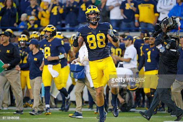 Jake Butt of the Michigan Wolverines celebrates a win over the Wisconsin Badgers at Michigan Stadium on October 1 2016 in Ann Arbor Michigan Michigan...