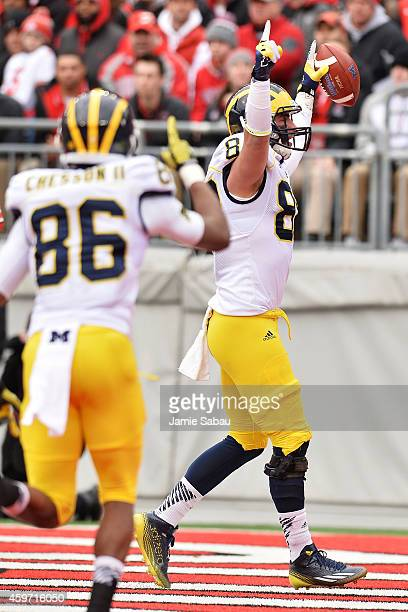 Jake Butt of the Michigan Wolverines celebrates after catching a 12yard touchdown pass against the Ohio State Buckeyes in the first quarter at Ohio...