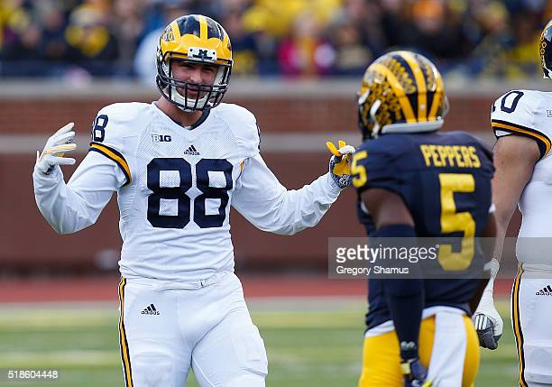 Jake Butt of the Michigan Wolverines has some fun talking to Jabrill Peppers during the Michigan Football Spring Game on April 1 2016 at Michigan...