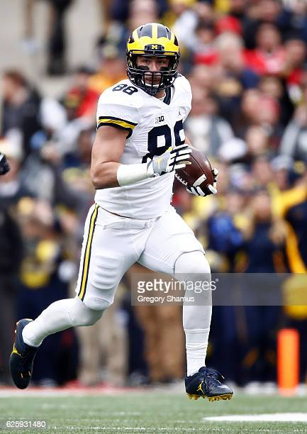 Jake Butt of the Michigan Wolverines runs with the ball after catching a pass during the first quarter against the Ohio State Buckeyes at Ohio...