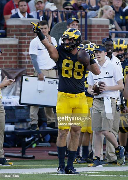 Jake Butt of the Michigan Wolverines signals a first down during the second half of a game against the Colorado Buffaloes at Michigan Stadium on...