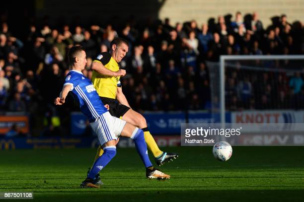 Jake Buxton of Burton Albion and Bersant Celina of Ipswich in action during the Sky Bet Championship match between Burton Albion and Ipswich Town at...