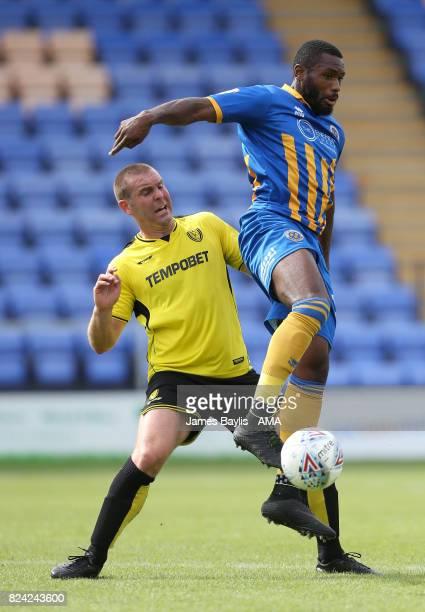 Jake Buxton of Burton Albion and Lenell JohnLewis of Shrewsbury Town during the PreSeason Friendly between Shrewsbury Town and Burton Albion at the...