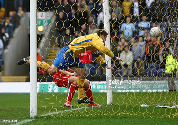 Jake Buxton of Mansfield Town heads the ball in to his own net under pressure from Stewart Downing of Middlesbrough to score an own goal during the...