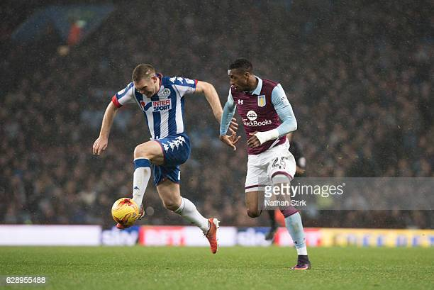 Jake Buxton of Wigan and Jonathan Kodjia of of Aston Villa Athletic in action during the Sky Bet Championship match between Aston Villa and Wigan...