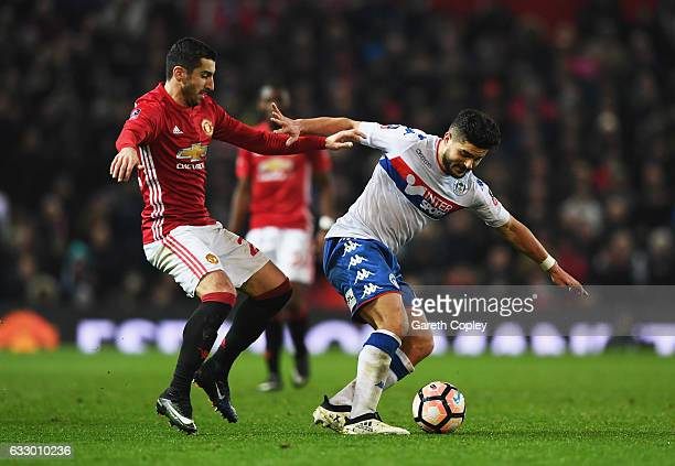 Jake Buxton of Wigan Athletic holds off Henrikh Mkhitaryan of Manchester United during the Emirates FA Cup Fourth round match between Manchester...
