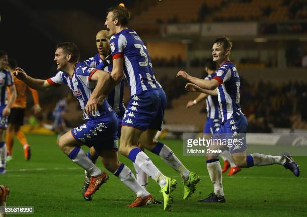 Jake Buxton of Wigan celebrates scoring his sides winning goal during the Sky Bet Championship match between Wolverhampton Wanderers and Wigan...