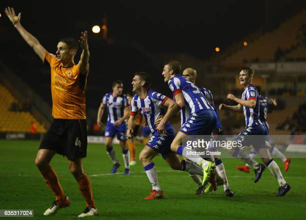 Jake Buxton of Wigan celebrates scoring his sides winning goal during the Sky Bet Championship match between Wolverhampton Wanderers and Wigan...